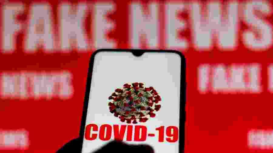 """Imagem ilustrativa do coronavírus em frente aos dizeres """"fake news"""" - Rafael Henrique/SOPA Images/LightRocket via Getty Images"""