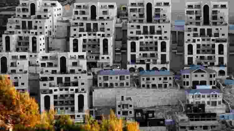 Assentamentos israelenses desafiam a lei internacional - GETTY IMAGES/AHMAD GHARABLI - GETTY IMAGES/AHMAD GHARABLI