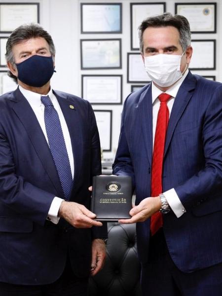 Luiz Fux e Ciro Nogueira  seguram Constituição em encontro no STF - reprodução/redes sociais