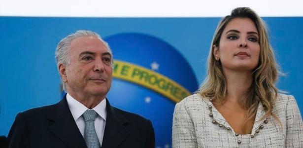 O presidente Michel Temer ao lado da primeira-dama Marcela, em cerimônia no Palácio do Planalto