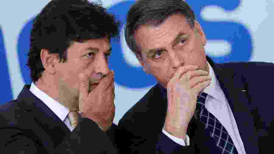 Presidente Jair Bolsonaro ao lado do ministro da Saúde, Luiz Henrique Mandetta, durante evento em Brasília - ADRIANO MACHADO