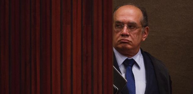 9.jun.2016 - O ministro Gilmar Mendes, presidente do TSE (Tribunal Superior Eleitoral), chega ao plenário para a sessão de julgamento da chapa Dilma-Temer