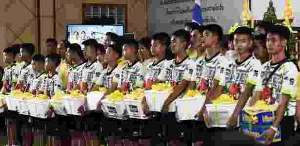 Os doze garotos e seu treinador de futebol  resgatados de uma caverna na Tailândia - Lillian Suwanrumpha/AFP