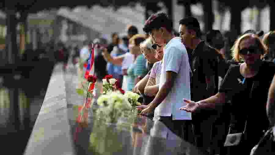 Amigos e familiares de vítimas dos atentados de 11 de setembro de 2001 prestam homenagens em memorial - Spencer Platt/Getty Images/AFP