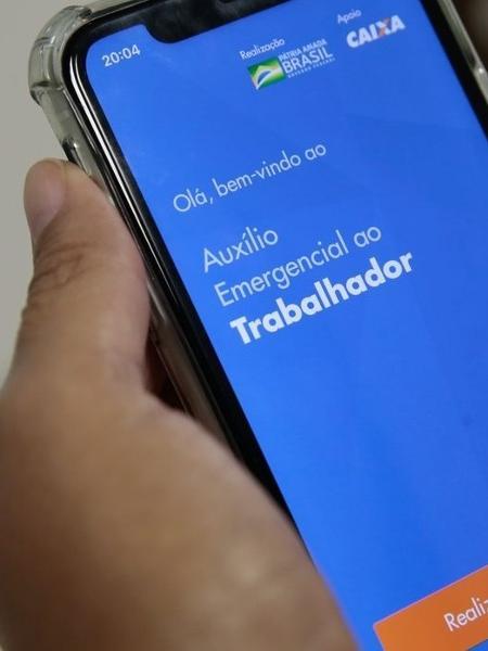 Auxílio emergencial pode ser consultado no celular - Marcello Casal Jr/Agência Brasil
