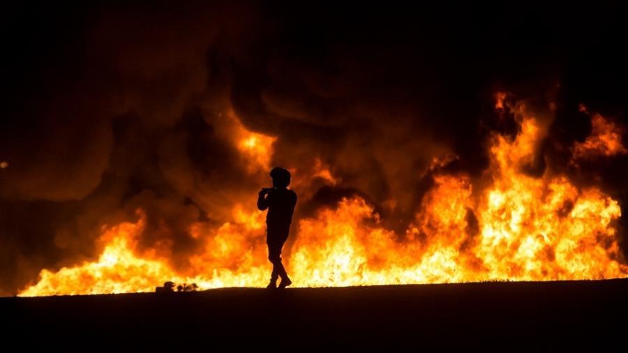 """Imagens legítimas do conflito - como esta - se misturam a uma avalanche de """"fake news"""" nas redes sociais - Getty Images"""