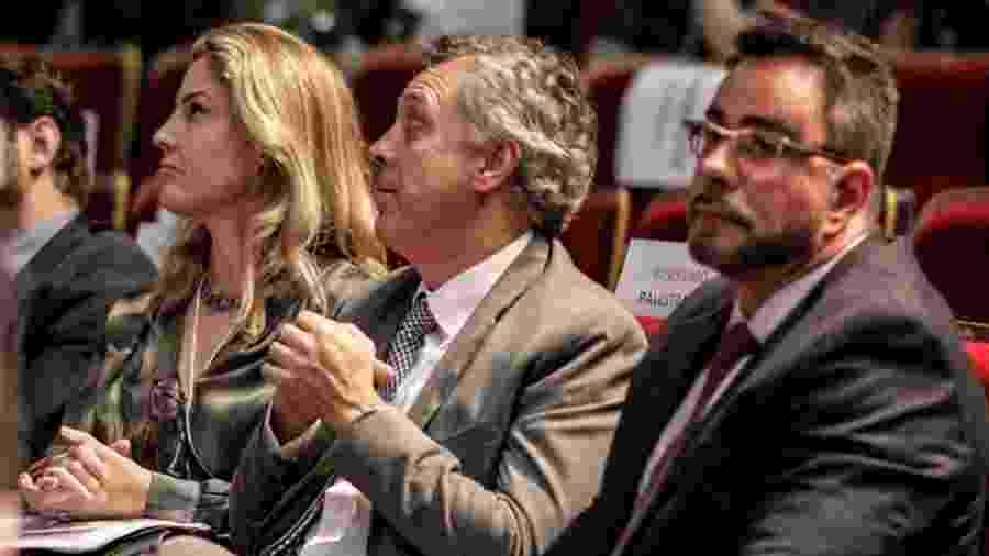 Gabriela Hardt, João Pedro Gebran Neto e Marcelo Bretas na plateia do Congresso Nacional sobre Macrocriminalidade e Combate à Corrupção no Teatro Positivo em Curitiba (PR) - EDUARDO MATYSIAK/FUTURA PRESS/FUTURA PRESS/ESTADÃO CONTEÚDO