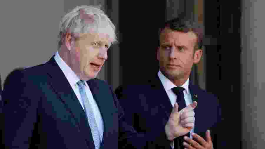 O presidente da França, Emmanuel Macron, e o primeiro-ministro do Reino Unido, Boris Johnson, após encontro para discutir o Brexit - Gonzalo Fuentes/Reuters