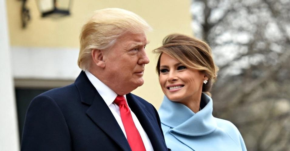20.jan.2017 - O presidente eleito dos EUA, Donald Trump, e sua mulher, Melania, deixam a Igreja Episcopal St. John's, em Washington DC, nesta sexta-feira (20), antes da cerimônia de posse