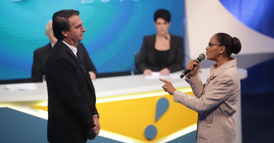 17.ago.2018 - Marina Silva (Rede) e Jair Bolsonaro (PSL) durante debate da RedeTV!/IstoÉ nesta sexta-feira (17)