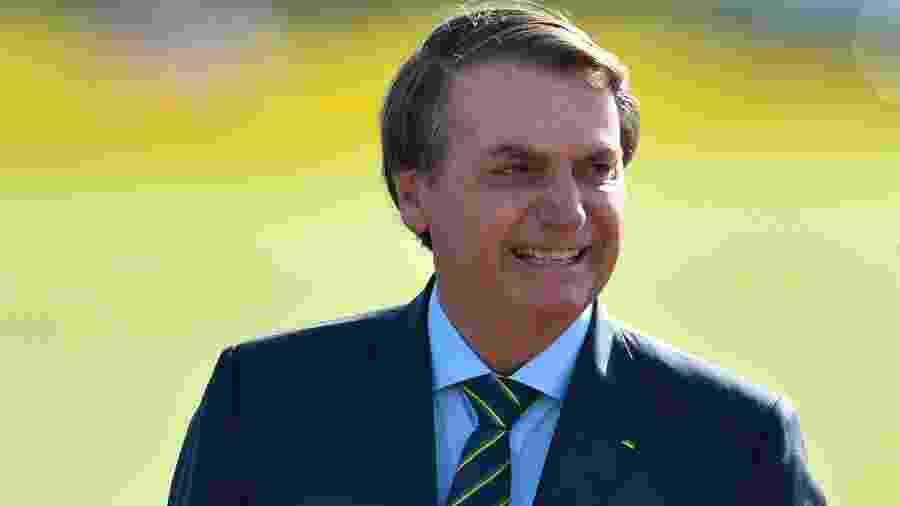17.dez.2019 - O presidente Jair Bolsonaro participa da cerimônia de hasteamento da bandeira, no Palácio da Alvorada - MATEUS BONOMI/AGIF/ESTADÃO CONTEÚDO