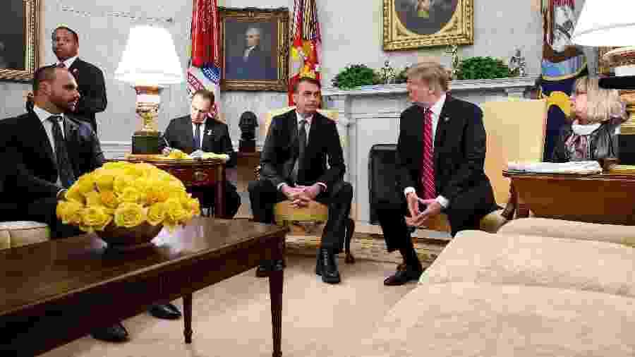 19.mar.2019 - Eduardo participa do encontro entre seu pai, Jair Bolsonaro, e o presidente dos EUA, Donald Trump - Isac Nóbrega/PR