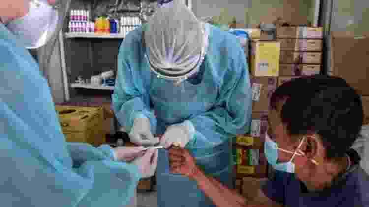Falta de testes prejudica esforços de se conhecer números reais da pandemia - AFP - AFP