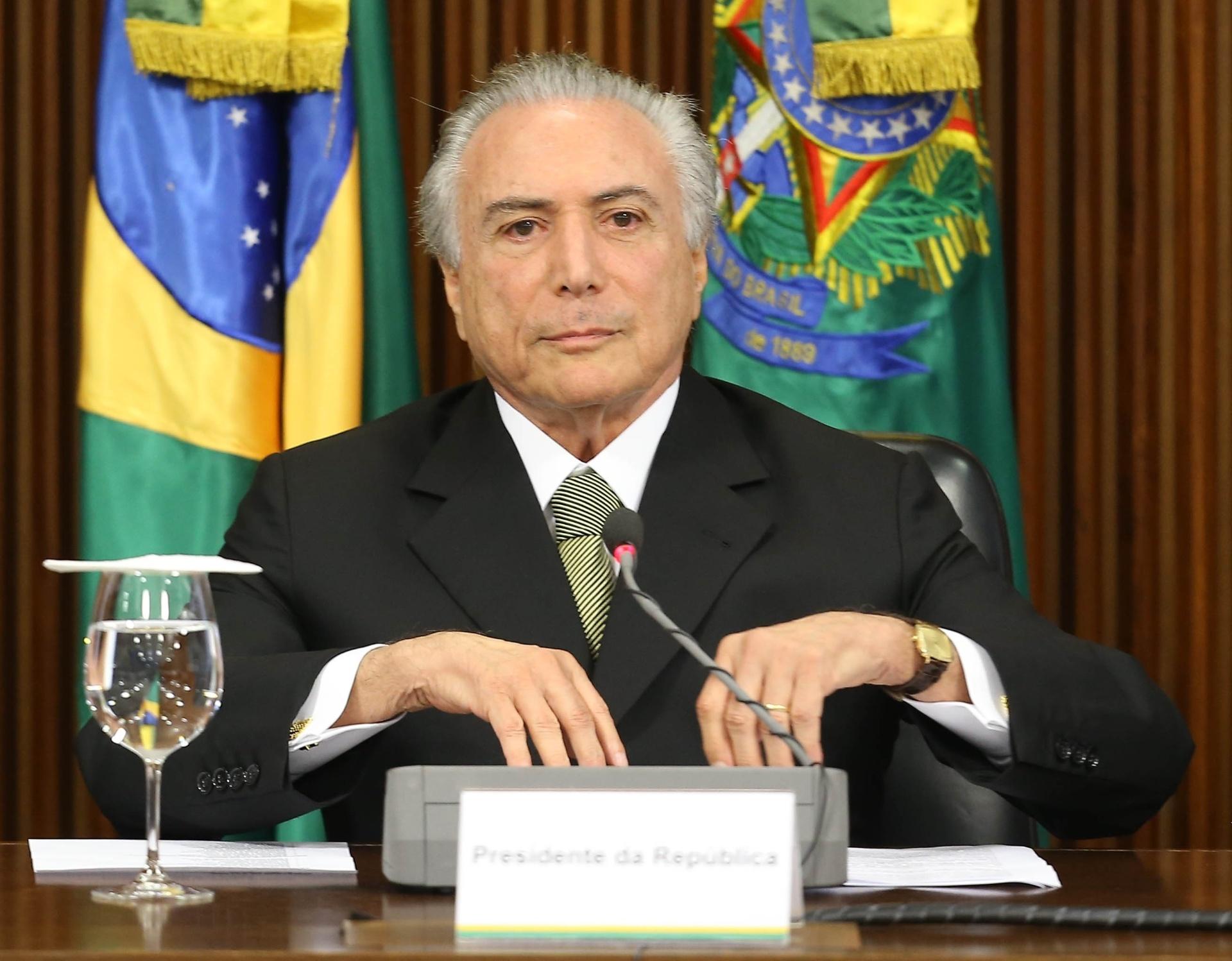 24.mai.2016 - O presidente em exercício, Michel Temer, anuncia medidas econômicas para reverter déficit fiscal, no Palácio do Planalto, em Brasília
