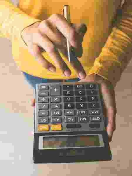 Calculadora, contas, cálculos, calcular, finanças - Getty Images/iStockphoto/Kritchanut