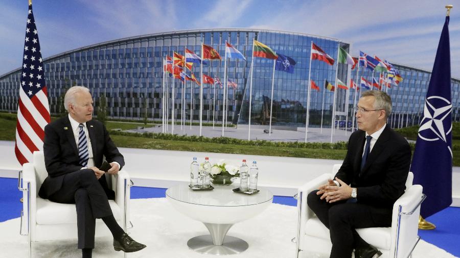 14.jun/2021 - O presidente dos Estados Unidos, Joe Biden, e o secretário- geral da Otan, Jens Stoltenberg - Stephanie Lecocq/Pool/AFP