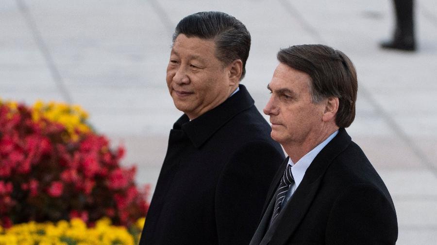 O presidente Jair Bolsonaro e o presidente da China, Xi Jinping - Noel Celis/AFP
