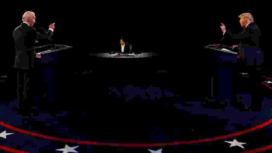 Presidente Donald Trump e o ex-vice-presidente Joe Biden durante o último debate da campanha presidencial dos EUA - Jim Bourg/Pool/Reuters