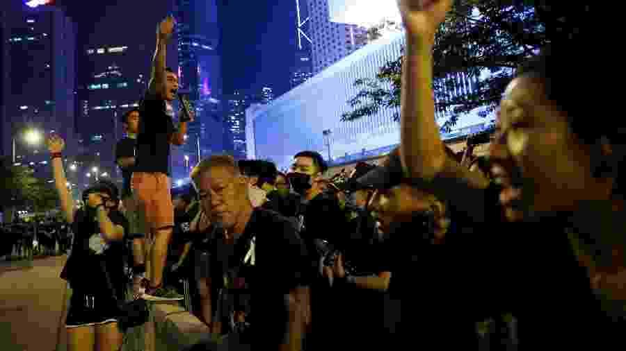 Jovens estão  na linha de frente dos protestos em Hong Kong - Thomas Peter/Reuters