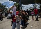 Países latino-americanos avaliam estatuto temporário para migrantes da Venezuela - Mauro Pimentel / AFP