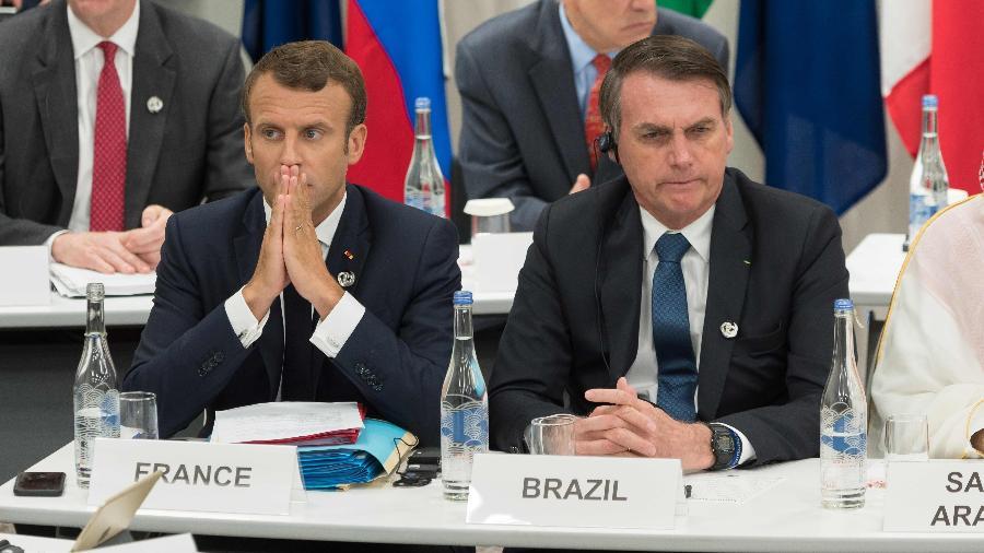 O presidente da França, Emmanuel Macron, e Jair Bolsonaro durante o encontro do G20, em Osaka (Japão) - JACQUES WITT/AFP