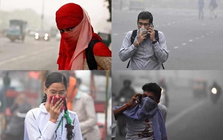 8.nov.2017 - Pessoas protegem o nariz em Nova Déli. O nível de poluição na cidade está cerca de 30 vezes superior ao indicado como seguro pela OMS (Organização Mundial da Saúde)