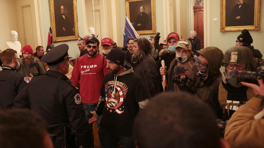 06 jan. 2021 - Apoiadores do presidente dos Estados Unidos, Donald Trump, invadiram o Congresso - Win McNamee/Getty Images