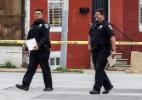 Faltando pouco para terminar mandato, Obama tenta reformar polícia de cidades violentas - Drew Angerer for The New York Times