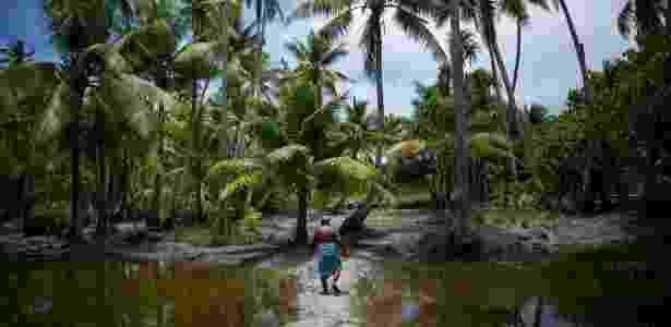 Kiribati, país remoto no Pacífico, começa a sentir os efeitos da elevação do mar - Josh Haner/The New York Times - Josh Haner/The New York Times