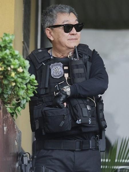 28.nov.2015 - O agente federal Newton Ishii, conhecido como Japonês da Federal - Giuliano Gomes/Folhapress