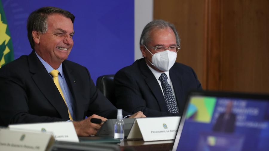O presidente Jair Bolsonaro ao lado do ministro da Economia, Paulo Guedes - Marcos Corrêa/PR