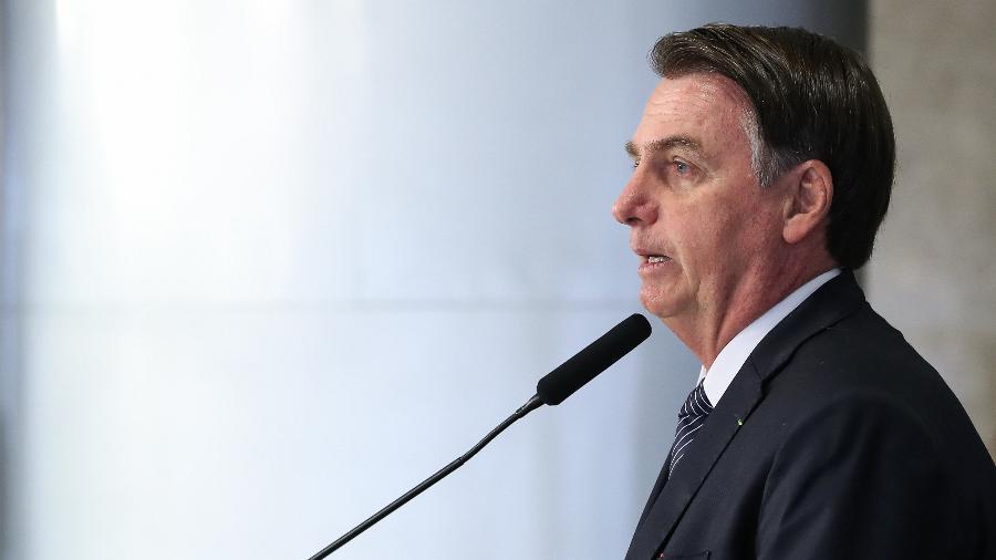 25.abr.2019 - Bolsonaro durante solenidade de assinatura do decreto que revoga o horário de verão - Marcos Corrêa/PR  ?Legenda da foto no banco de imagens?Legenda editorial da Imagem para exibição em webpages
