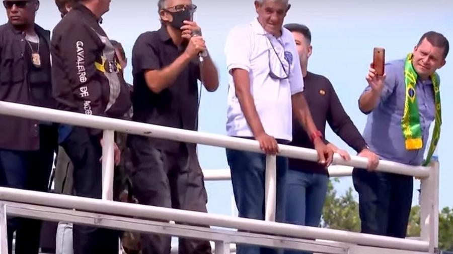 Max Guilherme Machado de Moura filma o presidente em ato no Rio - Reprodução