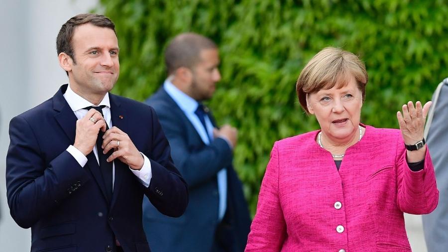 Presidente francês, Emmanuel Macron, e a chanceler alemã, Angela Merkel - Tobias SCHWARZ / AFP PHOTO