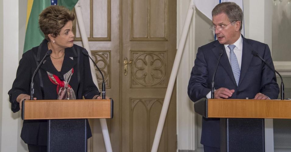20.out.2015 - A presidente Dilma Rousseff, do Brasil, e seu homólogo finlandês, Sauli Niinistö, em entrevista em Helsinque
