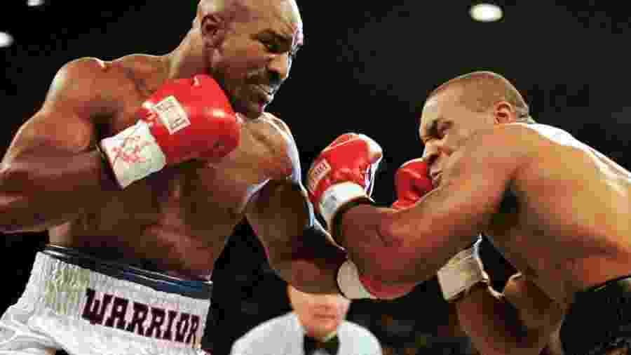 Evander Holyfield e Mike Tyson já se enfrentaram duas vezes - Gary Hershorn