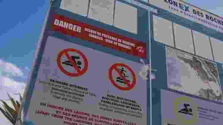 A ilha implementou medidas para proteger as pessoas dos ataques de tubarões - BBC