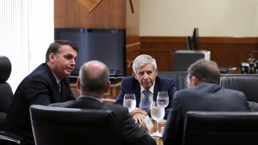 O presidente Jair Bolsonaro durante reunião com o ministro-chefe do GSI, general Augusto Heleno - Marcos Corrêa/PR