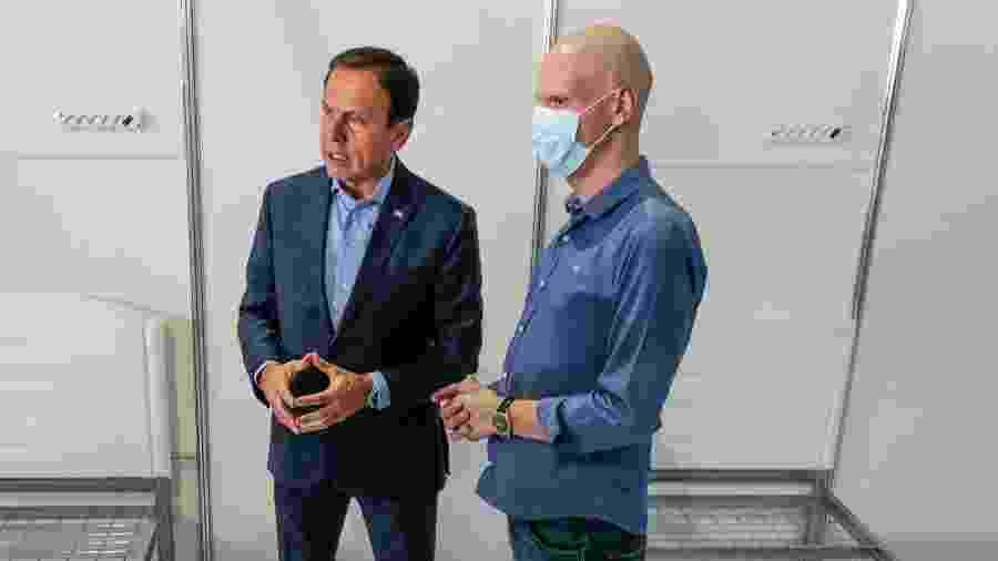 João Doria, governador de São Paulo, fala sobre combate ao coronavírus ao lado do prefeito de São Paulo, Bruno Covas - Miguel Schincariol/Getty Images