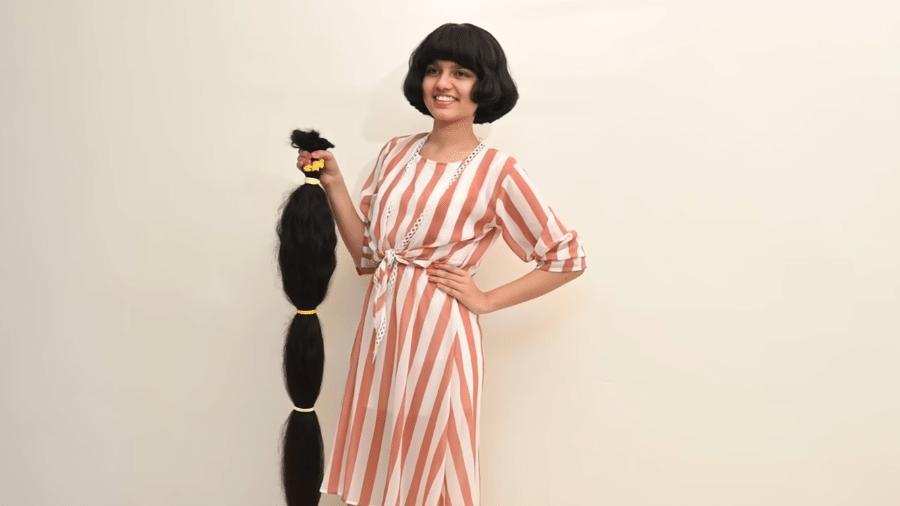 """Nilashani com o novo visual, após dizer adeus ao maior cabelo """"adolescente"""" do mundo - Reprodução/YouTube/Guinness Book"""