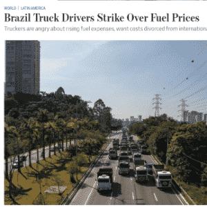 """""""Caminhoneiros entraram em greve no Brasil contra o aumento do preço da gasolina [...], ameaçando a recuperação letárgica do país e colocando o governo sem dinheiro na parede"""", escreveu o americano The Wall Street Journal - Reprodução"""