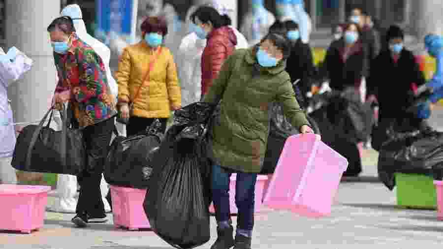 Pacientes deixam hospitais temporários em Wuhan, da China - Xinhua/Chen Yehua