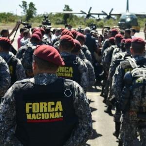 Agentes da Força Nacional de Segurança desembarcaram na Base Aérea de Boa Vista após massacre