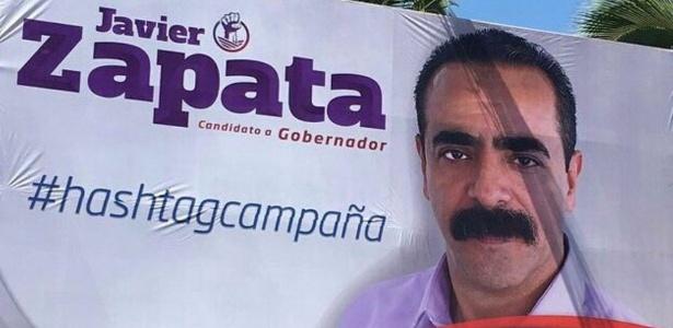 O candidato Javier Zapata em cartaz com a hashtag que virou motivo de piada