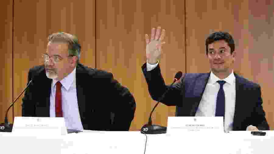 7.nov.2018 - Jungmann (e) e Moro juntos durante evento no Palácio da Justiça em Brasília (DF) - Fátima Meira/Estadão Conteúdo