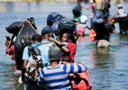 Migrantes haitianos rejeitam sugestão de deixar acampamento para obter refúgio no México