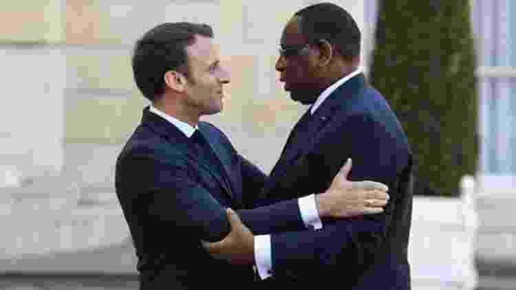 O presidente do Senegal é próximo do ministro Le Drian e eles se tratam pelo pronome informal 'tu'. Na foto, ele aparece em visita ao presidente Emmanuel Macron, em 2018  - AFP