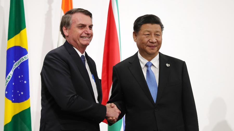 Presidente Jair Bolsonaro, do Brasil, e presidente  Xi Jinping, da China, durante Encontro do G20, em Osaka, em junho de 2019 - Mikhail KLIMENTYEV / AFP
