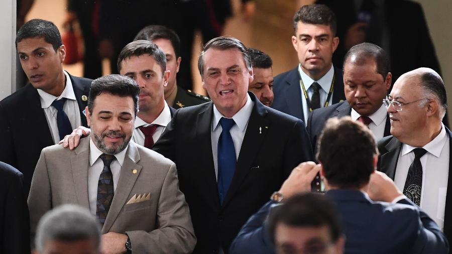 10.jul.2019 - O presidente Jair Bolsonaro ao lado do deputado federal pastor Marco Feliciano (Pode-SP) - Evaristo Sá/AFP