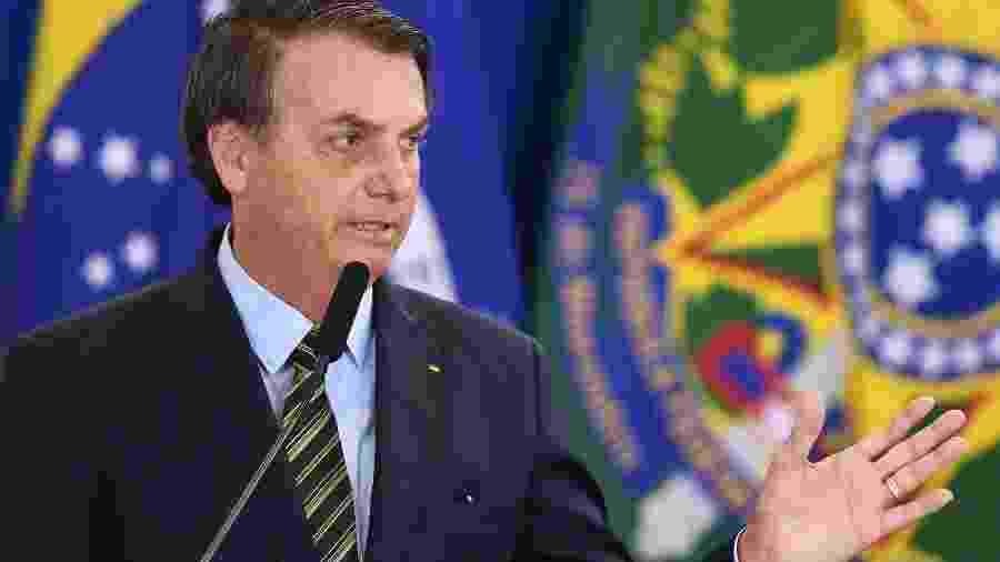 O presidente Jair Bolsonaro discursa em evento com militares hoje no Palácio do Planalto - EVARISTO SA/AFP